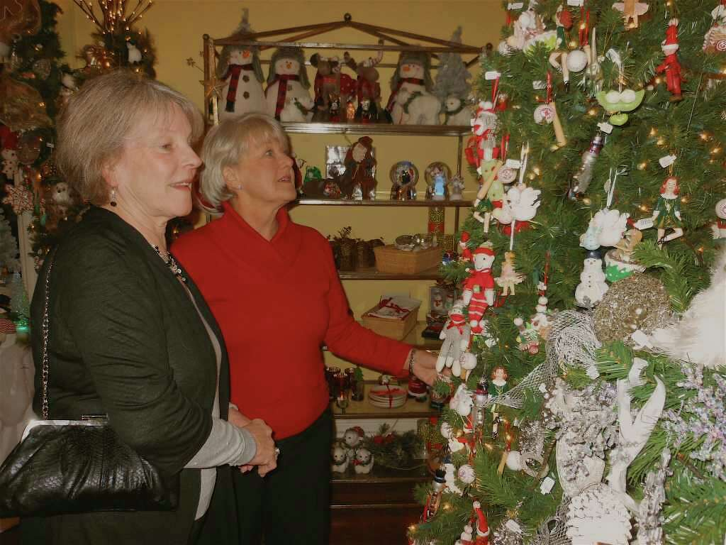 Fairfielders Susan Burns and Linda Lanzo look at ornaments hanging on a Christmas  tree in the