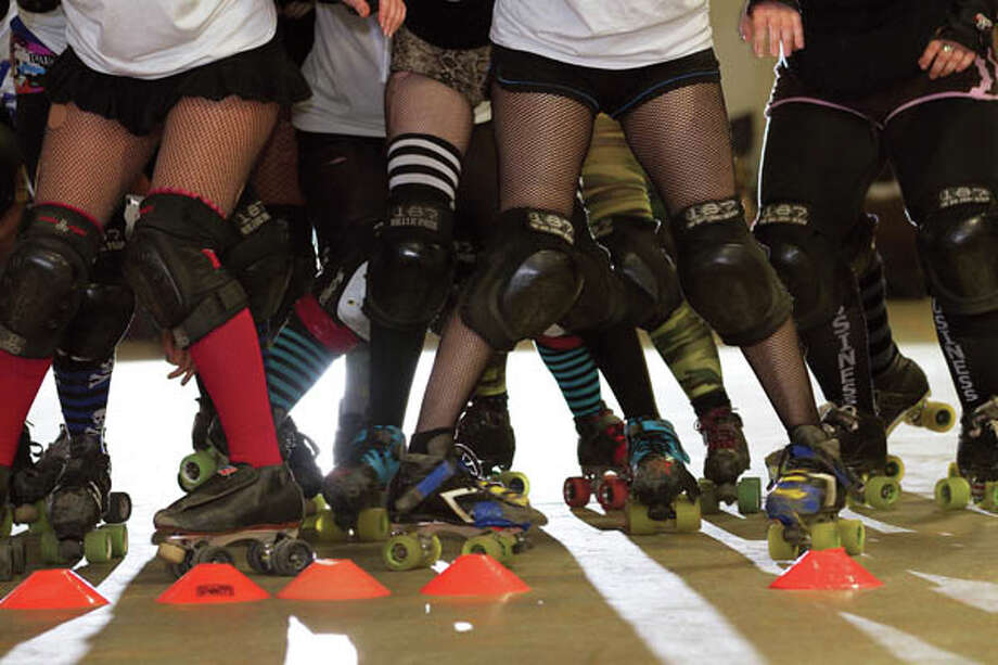 On the Roller Derby Runway: Fishnets, kneepads and roller blades. (Photo by Jill Kaiser/Explore) Photo: Linda S Conley