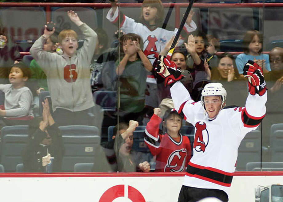Everybody celebrates when the Albany Devils score. (Photo courtesy James DiBianco Jr./Albany Devils) Photo: James DiBianco / db Photography (c)