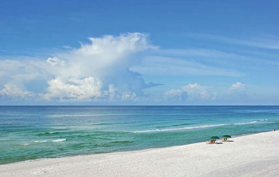 Sugar white beaches frame a lush, neo-traditional town. (Photo Courtesy Rosemary Beach Cottage Rental Company)
