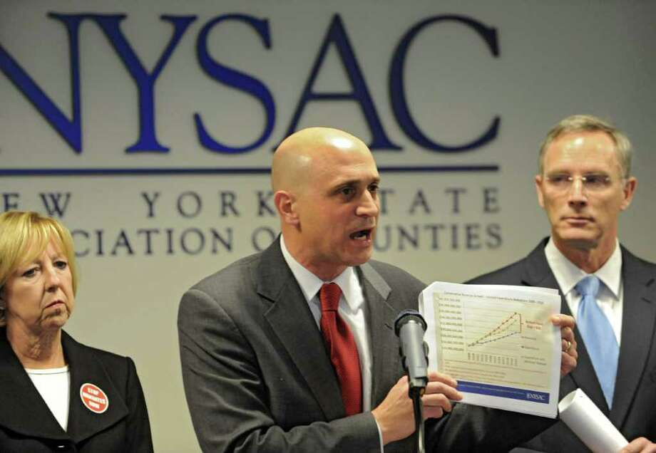 Stephen Acquario, Executive Director NYS County Executives Association, shows a chart during a press conference at the NYS Association of Counties on Friday, Dec. 2, 2011 in Albany, N.Y. (Lori Van Buren / Times Union) Photo: Lori Van Buren