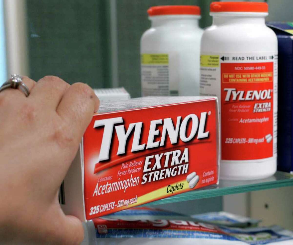 ** CORRECTS TO REMOVE REFERENCE TO NYQUIL ** Tylenol Extra Strenth is shown in a medicine cabinet at a home in Palo Alto, Calif., Tuesday, June 30, 2009. In a series of votes Tuesday, a Food and Drug Administration panel endorsed lowering the maximum dose of over-the-counter acetaminophen _ the key ingredient in Tylenol, Excedrin and other medications. (AP Photo/Paul Sakuma)