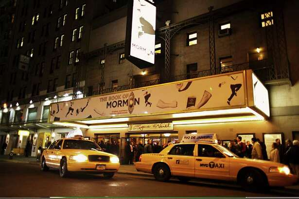 """The theater marquee for """"The Book of Mormon,"""" which was not illuminated that day in honor of Elizabeth Taylor, on Broadway in New York, on March 25, 2011. The musical that ridicules the Mormon religion from the creators of """"South Park"""" has been denounced by some conservative Mormons, but the church itself has signaled members turn the other cheek. (Richard Perry/The New York Times)"""