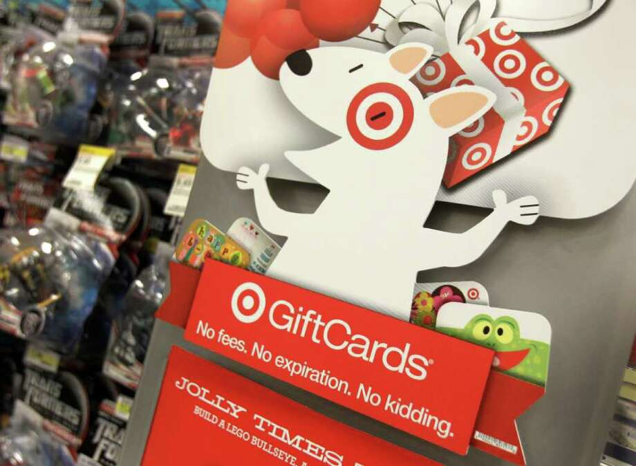 AMY SANCETTA : ASSOCIATED PRESS IT'S A GIFT: The Target mascot dog advertises gift cards at a Target store in Mayfield Heights, Ohio. Gift cards are a popular option for holiday shoppers and there are consumer protections that come with them. Photo: Amy Sancetta / AP