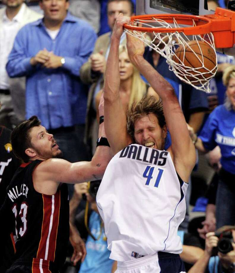 Dallas Mavericks' Dirk Nowitzki (41) dunks past Miami Heat's Mike Miller (13) during the second half of Game 5 of the NBA Finals basketball game Thursday, June 9, 2011, in Dallas. Photo: AP