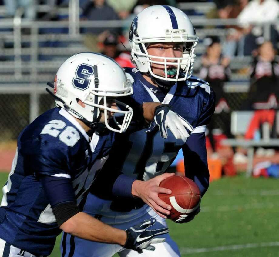 Highlights from boys football action between Fairfield Warde and Staples in Westport, Conn. on Saturday November 5, 2011. Staples QB #16 Jack Massie hands of the ball to #28 Jon Heil. Photo: Christian Abraham / Connecticut Post