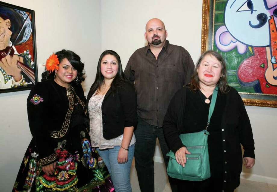 OTS/HEIDBRINK - Olma Arellano (Singer), Jaclyn Valdez, Jeff Hull and Rosa Fernandez (Artists) were at the Mariachi themed exhibit on 11/29/2011 at Centro Cultural Aztlan. names checked photo by leland a. outz Photo: LELAND A. OUTZ, For The Express-News / SAN ANTONIO EXPRESS-NEWS