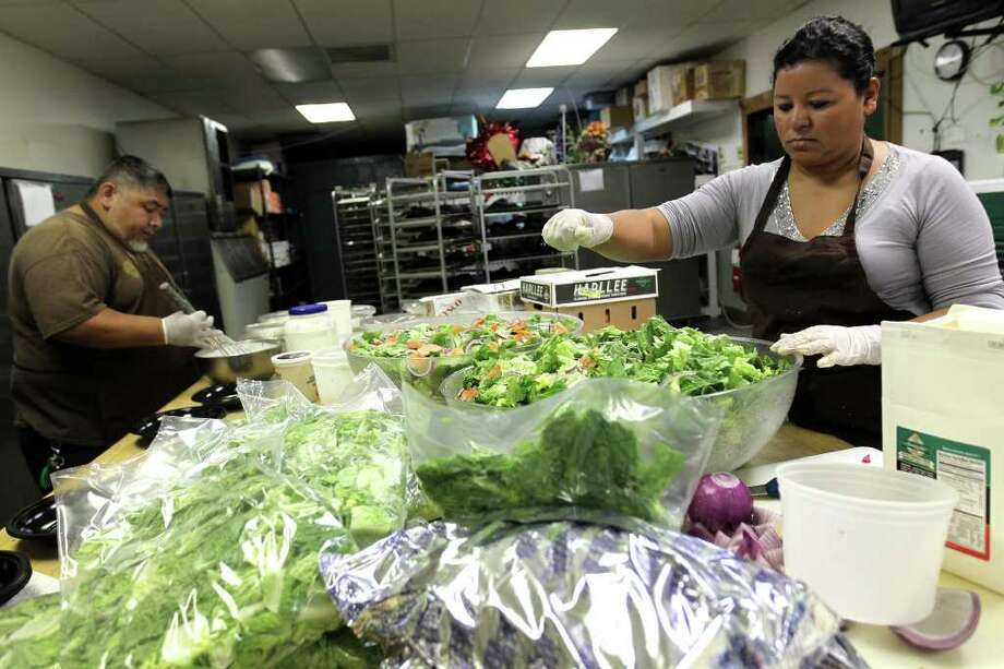 Teresa Dietz makes huge salad bowls for the buffet during preparations for holiday parties at Pedrotti's Ranch, Friday, December 3, 2011. Photo: JENNIFER WHITNEY, Jennifer Whitney/ Special To The Express-News / Jennifer Whitney/special to the Express-News