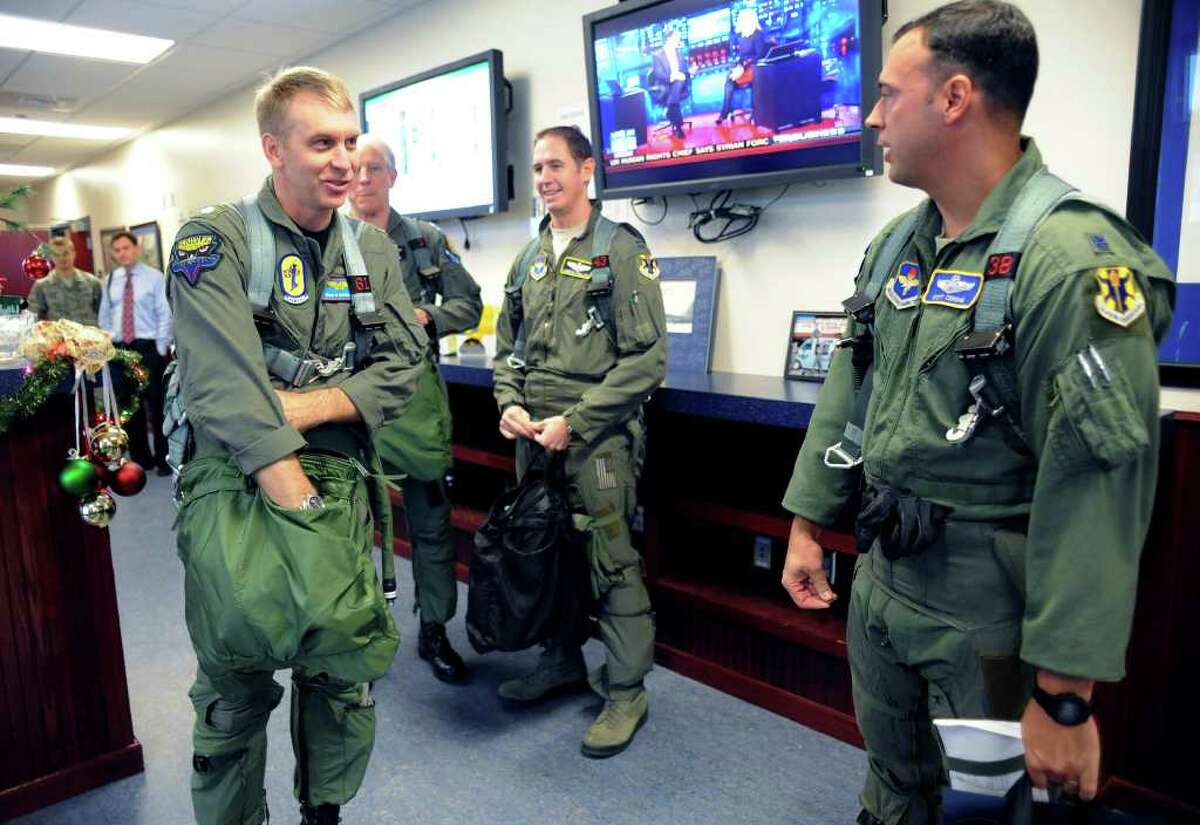 Navy Cmdr. Brian Danielson, left, prepares to fly with Air Force Lt. Col. Scott Cerone, right, in a Randolph Air Force Base Heritage Flight T-38 to honor his father, Air Force Maj. Ben Danielson, and the air crew that attempted to rescue him when he was shot down during the Vietnam War on Dec. 5, 1969.