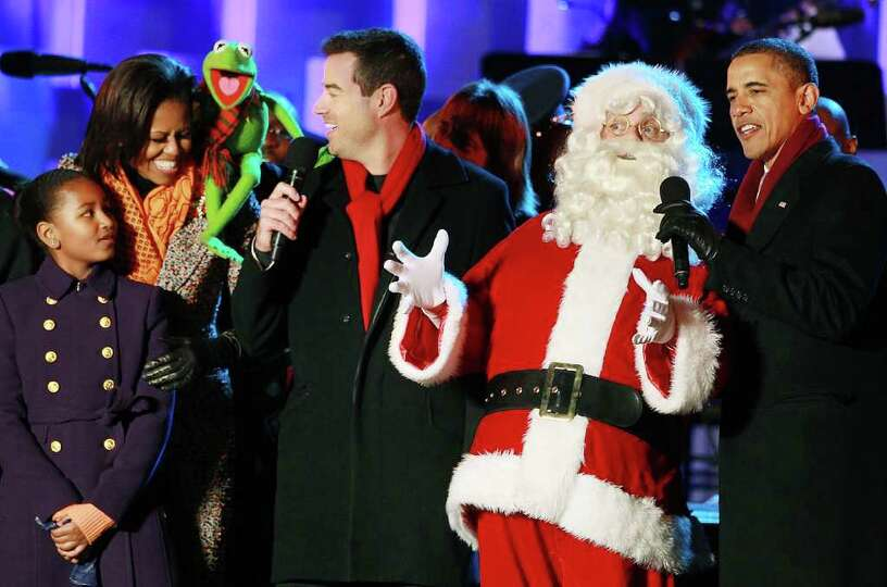 U.S. President Barack Obama (R), Santa Clause (2nd-R), Carson Daly (C), Kermit the Frog, first lady