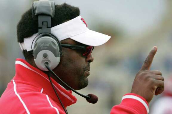 University of Houston head coach Kevin Sumlin gives the offense a signal as the team break away during the fourth quarter quarter of a NCAA football game, Friday, Nov. 25, 2011, in H.A. Chapman Stadium in Tulsa. The University of Houston won 48-16. ( Nick de la Torre / Houston Chronicle )