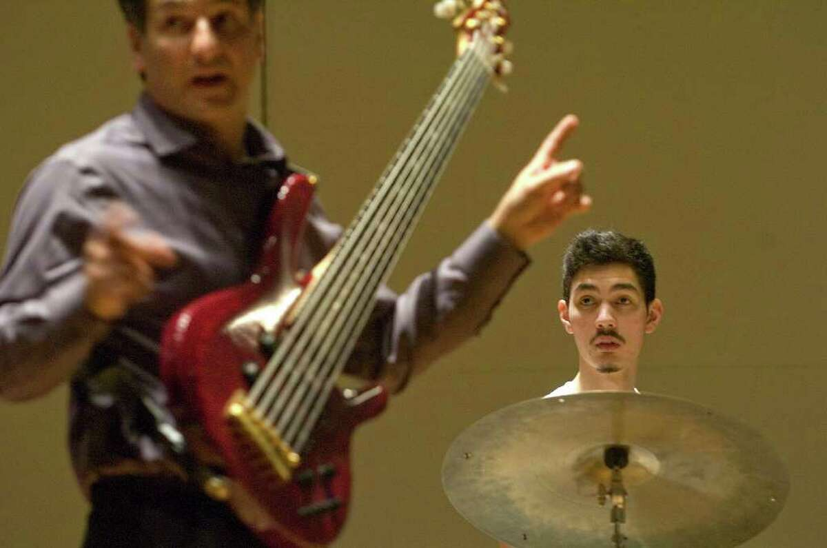 Bass player John Patitucci, left, gives directions to Western Connecticut State University Student Matt Hsiung and others during Patitucci's visit to WestConn's midtown campus on Friday, Dec. 2, 2011.