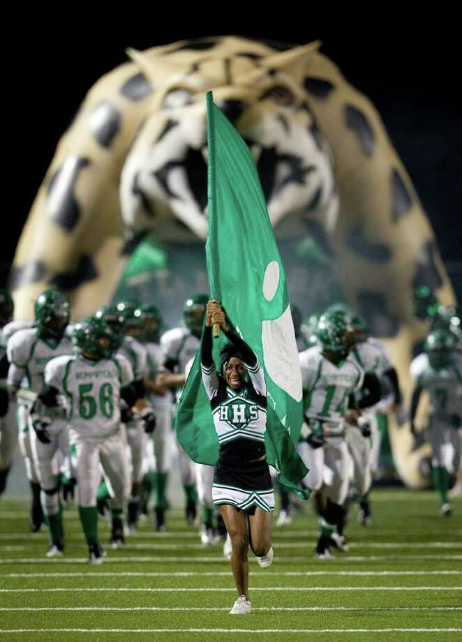 A Hempstead cheerleader leads the team onto the field. Photo: Smiley N. Pool, Houston Chronicle / © 2011  Houston Chronicle