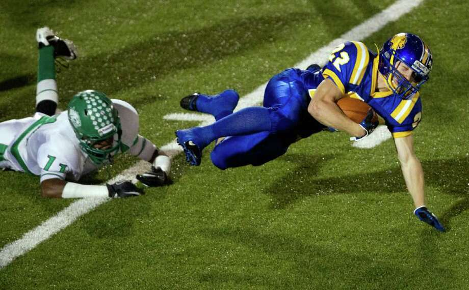 "Blanco running back  Colton Childress (22) is tripped up by Hempstead defensive back Trechel ""Trent"" Momon. Photo: Smiley N. Pool, Houston Chronicle / © 2011  Houston Chronicle"