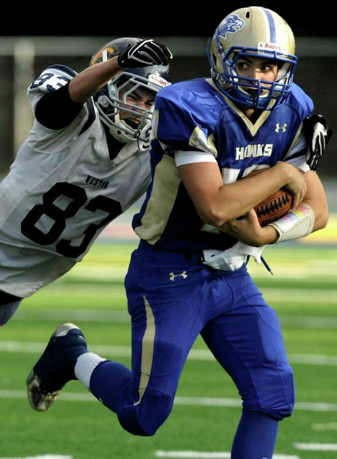 Weston's Matt Keeney reaches for Newtown quarterback Greg Frattaroli during their game at Newtown High School on Saturday, Oct. 1, 2011. Newtown beat Weston 41-7. Photo: Jason Rearick / The News-Times