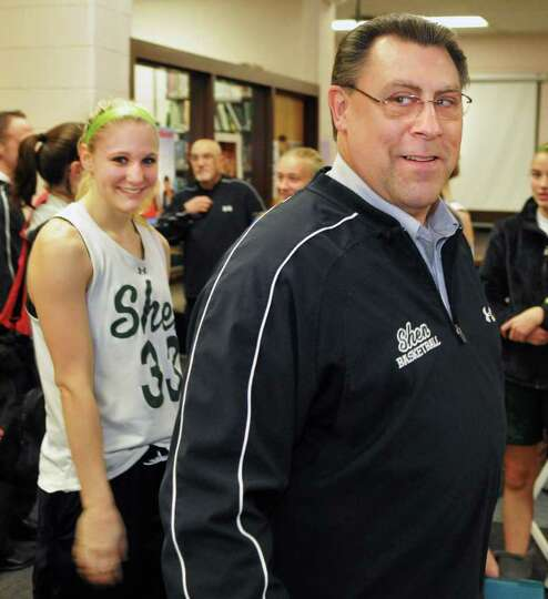 Shenendehowa girls' basketball player Emily Weber, left, and coach Ken Strube  during a press confer