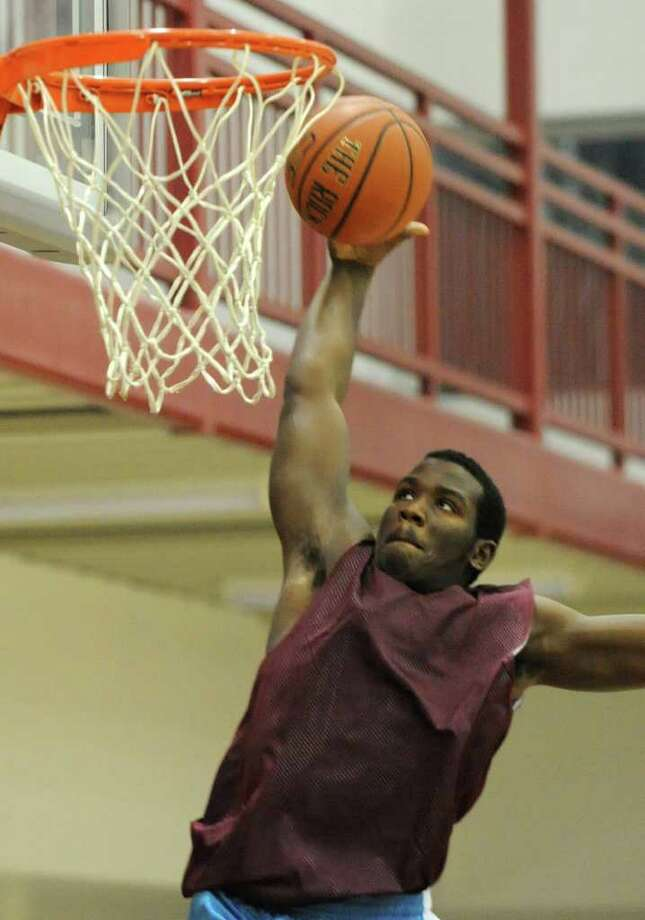 Watervliet's Antoine Johnson makes a layup during a basketball scrimmage with Troy on Friday, Dec. 2, 2011 in Watervliet, N.Y. (Lori Van Buren / Times Union) Photo: Lori Van Buren