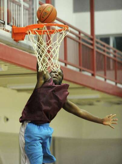 Watervliet's Antoine Johnson makes a layup during a basketball scrimmage with Troy on Friday, Dec. 2