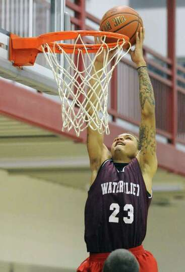 Watervliet's Jordan Gleason makes a layup during a basketball scrimmage with Troy on Friday, Dec. 2,