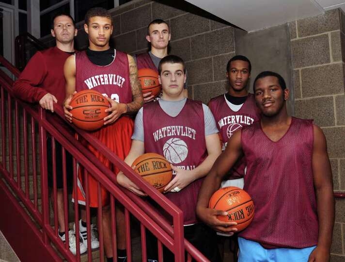 From left, Watervliet basketball coach Orli DeBacco and the team's starting five Jordan Gleason, Gri