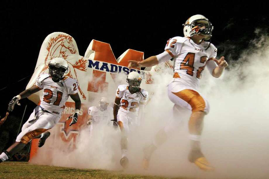 Members of the Madison Mavericks take the field before their Class 5A Division I state quarterfinal game with Harlingen Friday, Dec. 2, 2011 at Javelina Stadium in Kingsville. Photo: EDWARD A. ORNELAS, SAN ANTONIO EXPRESS-NEWS  / © SAN ANTONIO EXPRESS-NEWS (NFS)
