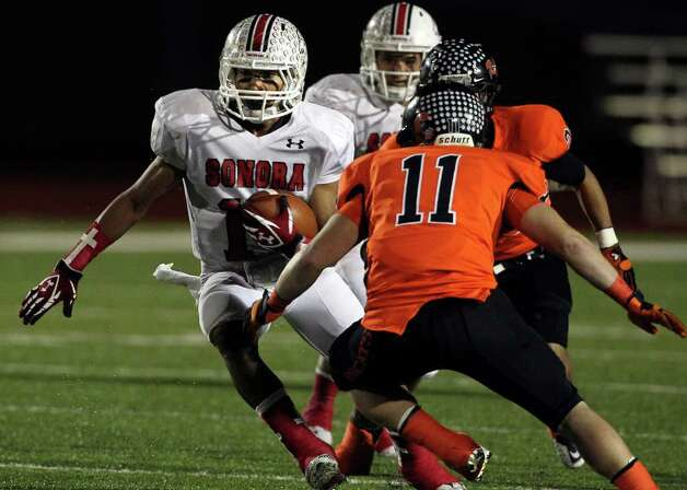 Sonora receiver Imoni Cross moves upfield as Refugio plays Sonora at Heroes Stadium in the Class 2A quarterfinals on Friday, Dec. 2, 2011. Photo: TOM REEL, SAN ANTONIO EXPRESS-NEWS  / © 2011 San Antonio Express-News