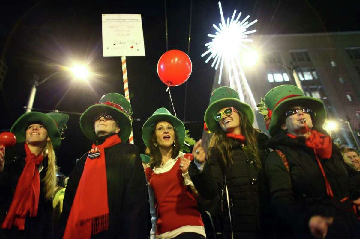 The Llew Crew performs during the 25th annual Great Figgy Pudding street corner caroling competition on Friday, December 2, 2011 in downtown Seattle. The event is a fundraiser for the Pike Market Senior Center & Downtown Food Bank.