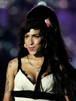"FILE  - In this June 27, 2008 file photo, British singer-songwriter Amy Winehouse performs at the 46664 charity concert in honor of Nelson Mandela's 90th birthday in London. Winehouse had written all the songs that were to appear on her third album. She even picked out song titles. But music producer Salaam Remi said the singer was not rushing to release that new material. Only two of the tracks Winehouse wrote were recorded and appear on her compilation album, ""Lioness: Hidden Treasures."" It will be out on Dec. 5. (AP Photo/Lefteris Pitarakis, File) Photo: Lefteris Pitarakis, Associated Press / AP2008"