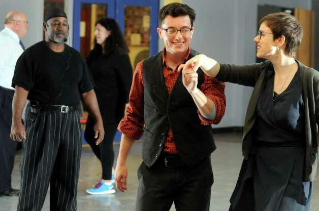 Christopher Argyros, center, learns dance steps with his girlfriend Laura Blosser during ballroom dance lessons on Thursday, Nov. 3, 2011, at Albany High in Albany, N.Y. Instructor Hershell Allen, left, watches their progress. (Cindy Schultz / Times Union) Photo: Cindy Schultz