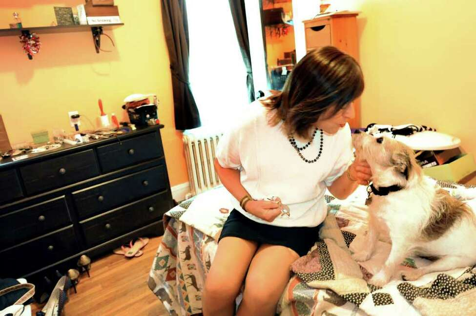 Mona Rae Mason and her Jack Russell in her room on May 24, 2011, in Albany, N.Y. (Cindy Schultz / Times Union)