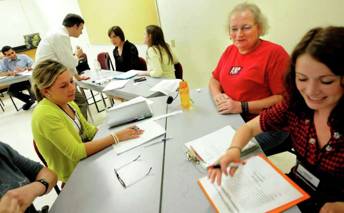 Wendy Moore of Albany, second from right, works with student clinicians Kaleigh McGrouty, left, and Maura Murray, right, during a voice modification class for transgender clients on Monday, June 27, 2011, at the College of Saint Rose in Albany, N.Y. (Cindy Schultz / Times Union)