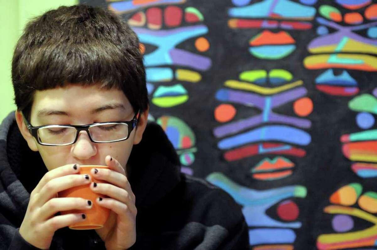 Evan LaFortune, 18, a transgender teenage boy, sips tea on Tuesday, Nov. 22, 2011, at Lil' Buddha Tea in Albany, N.Y. (Cindy Schultz / Times Union)