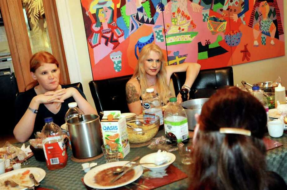 Drew Cordes of Albany, left, shares a meal with other gender-reassignment surgery patients at the bed and breakfast facility on Sunday, May 29, 2011, at Centre Metropolitain de Chirurgie Plastique in Montreal, Quebec in Canada. (Cindy Schultz / Times Union) Photo: Cindy Schultz