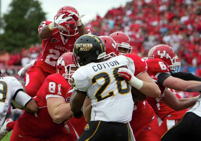 Houston Cougars running back Michael Hayes (29) leaps over the Southern Mississippi defense for a to