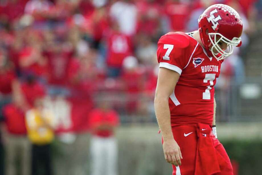 Houston Cougars quarterback Case Keenum hangs his head as he comes off the died after the Southern Mississippi defensive force the Cougars to punt on a drive during the first half of the C-USA Championship at Robertson Stadium, Saturday, Dec. 3, 2011, in Houston. Photo: Smiley N. Pool, Houston Chronicle / © 2011  Houston Chronicle