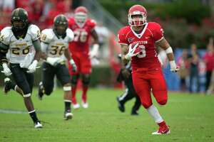 Houston Cougars wide receiver Justin Johnson (3) races for a long gain to set up a touchdown against Southern Mississippi during the first half of the C-USA Championship at Robertson Stadium, Saturday, Dec. 3, 2011, in Houston. ( Smiley N. Pool / Houston Chronicle )