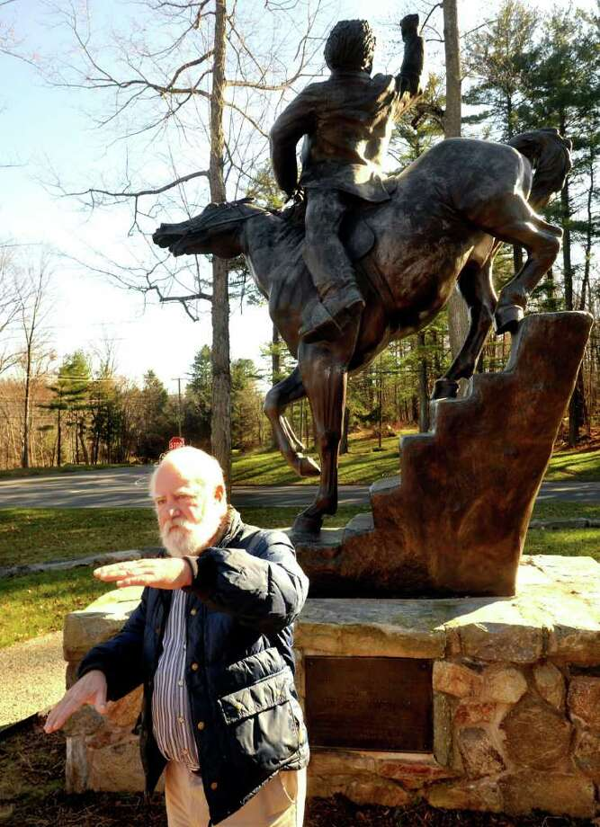 Dan Cruson, author and historian, talks in front of a statue of General Israel Putnam,while leading the Annual Walk in the Park at Putnam Memorial Park in Redding Saturday, Dec. 3, 2011. Photo: Michael Duffy