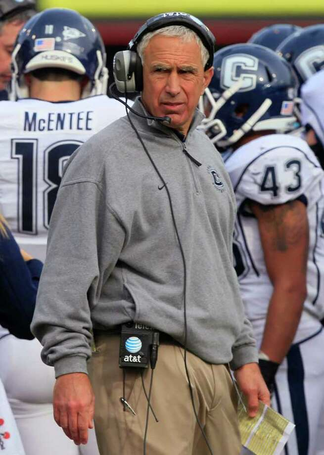 Connecticut head coach Paul Pasqualoni looks on during a time out in the first half of an NCAA college football game against Cincinnati, Saturday, Dec. 3, 2011, in Cincinnati, Ohio. (AP Photo/Al Behrman) Photo: Al Behrman, Associated Press / AP