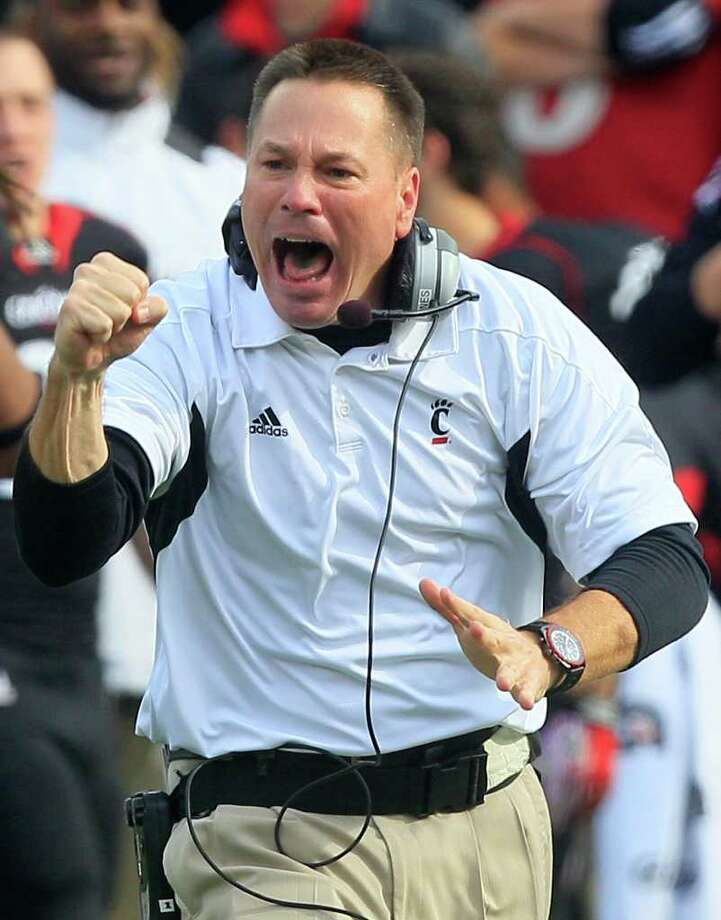 Cincinnati head coach Butch Jones urges on is players in the first half of an NCAA college football game against Connecticut, Saturday, Dec. 3, 2011, in Cincinnati, Ohio. (AP Photo/Al Behrman) Photo: Al Behrman, Associated Press / AP