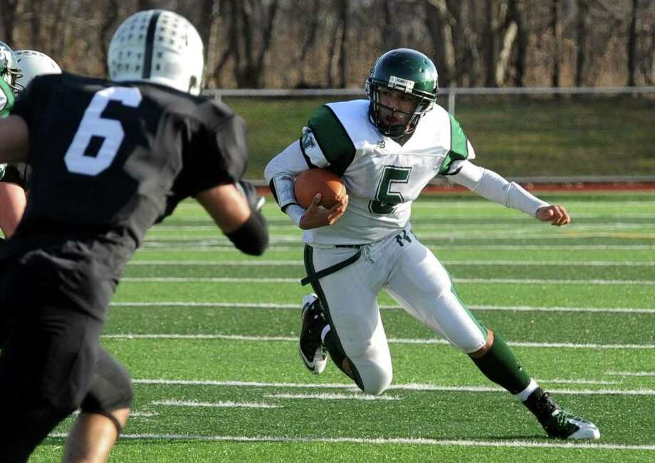 Norwalk's Delshawn Wilson weaves his way around the field as he carries the ball during CIAC Class LL boys football semifinal action against Xavier in West Haven, Conn. on Saturday December 3, 2011. Photo: Christian Abraham / Connecticut Post