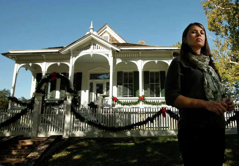 JOHNNY HANSON PHOTOS : CHRONICLE  DIFFICULT ASSIGNMENTS: Kimberly Wolfe, a native of Denton,  is now the buildings curator for the Heritage Society. Each week, she visits some of the city's most historic structures, including the Pillot House, shown, to check for damages. Photo: Johnny Hanson / © 2011 Houston Chronicle