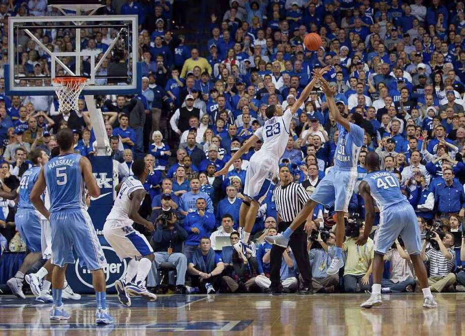 Kentucky's Anthony Davis (23) puts his 6-foot-10 frame to good use, blocking a game-winning shot attempt by North Carolina's John Henson in the closing moments of the second half on Saturday at Rupp Arena. Photo: AP Photo/The News & Observer,  Robert Willett