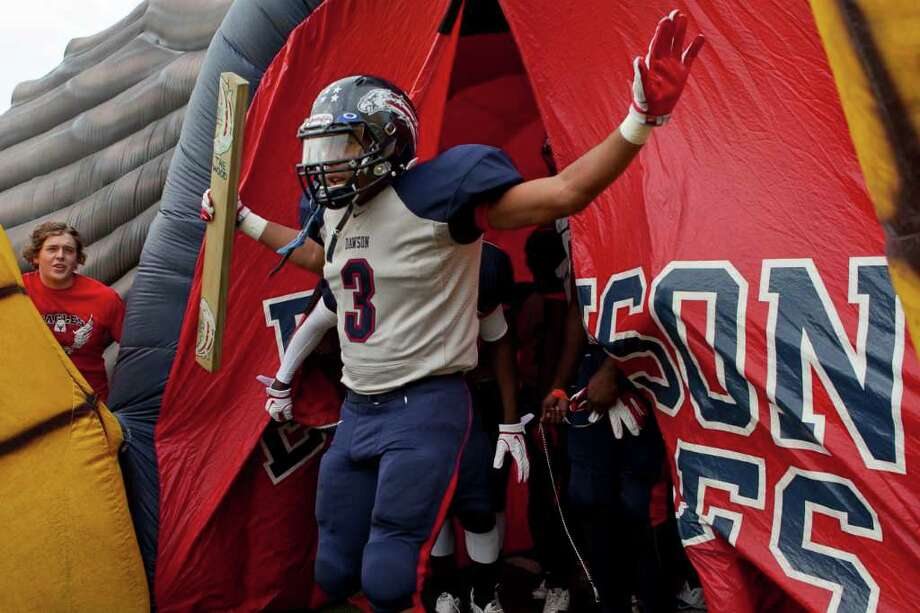 The Dawson Eagles make thier entrance onto the field at they prepare to face off against Angleton in the Class 4A Div. I Region III championship Saturday afternoon December 3, 2011 at Pearland Stadium. Dawson's 27-23 win will take them to the Alimo Dome next week.