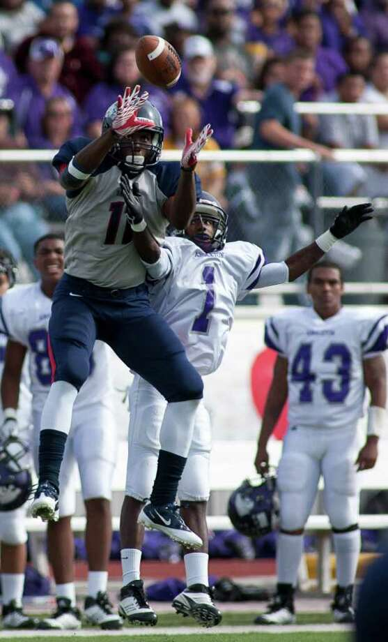 Eagle wide receiver Tony Upchruch (11) pulls in a reception over Wildcat defender Gerard Scott (1) as Angleton and Dawson face off in the Class 4A Div. I Region III championship Saturday afternoon December 3, 2011 at Pearland Stadium. Dawson's 27-23 win will take them to the Alimo Dome next week.