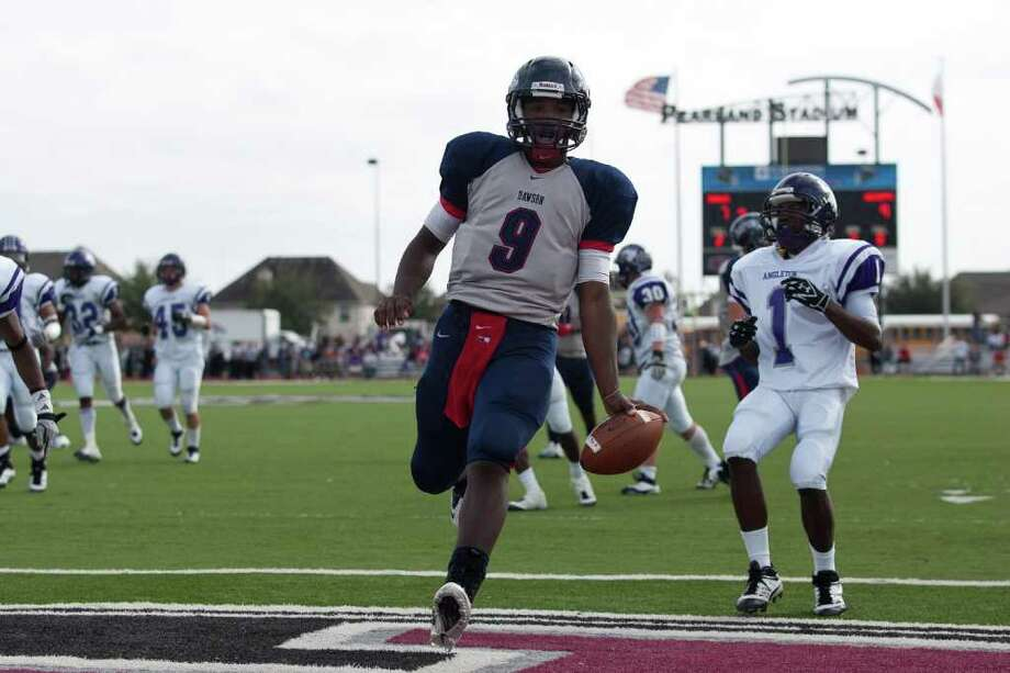 Eagle quarterback Garry Kimble crosses the goal line for his second rushing touchdown in the first half as Angleton and Dawson face off in the Class 4A Div. I Region III championship Saturday afternoon December 3, 2011 at Pearland Stadium. Dawson's 27-23 win will take them to the Alimo Dome next week.