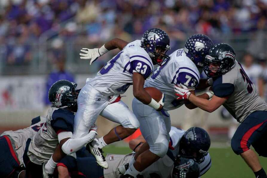 Wildcat fullback Josh West (23) rushes in the first half as Angleton and Dawson face off in the C