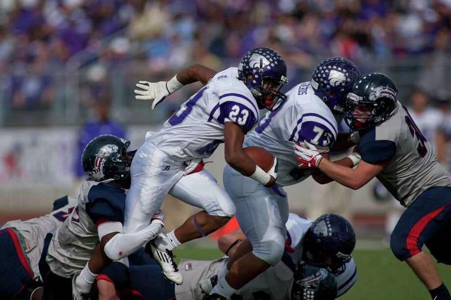 Wildcat fullback Josh West (23) rushes in the first half as Angleton and Dawson face off in the Class 4A Div. I Region III championship Saturday afternoon December 3, 2011 at Pearland Stadium. Dawson's 27-23 win will take them to the Alimo Dome next week.  Nathan Lindstrom/Special to the Chronicle  ©2011 Nathan Lindstrom Photo: Nathan Lindstrom, Lindstrom Photography LLC / ©2011 Nathan Lindstrom