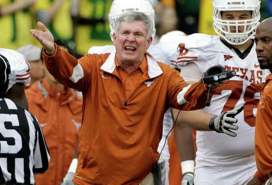 Texas head coach Mack Brown reacts to play in the first half of an NCAA college football game against Baylor, Saturday, Dec. 3, 2011, in Waco. Photo: Tony Gutierrez, Associated Press
