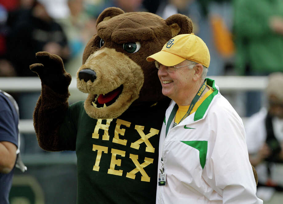 Baylor University president Ken Starr (right) poses with the university mascot before the start of an NCAA college football game against Texas, Saturday, Dec. 3, 2011, in Waco. Photo: Tony Gutierrez, Associated Press / AP