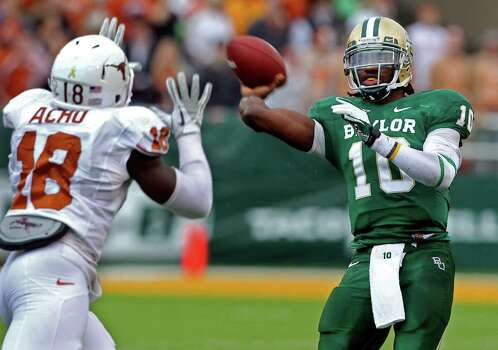 Bears quarterback Robert Griffin III fires under pressure from the Longhorns' Emmanuel Acho as Baylor hosts Texas at Floyd Casey Stadium in Waco on  Saturday, Dec. 3, 2011. Photo: TOM REEL, SAN ANTONIO EXPRESS-NEWS  / © 2011 San Antonio Express-News